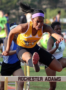Michaiah Thomas, Oxford, took home first place honors in the 110-meter hurdle event during Oakland Activities Association varsity track action at Rochester High School Thursday, May 8, 2014. (For the Oakland Press / LARRY McKEE)