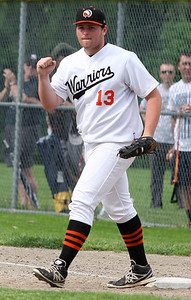 Randy Righter, Birmingham Brother Rice, pumps his fist after recording the final out of an inning during district baseball action against West Bloomfield at Birmingham Groves High School Tuesday, May 27, 2014. (Special to The Oakland Press / LARRY McKEE)