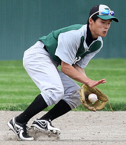 Daiki Nishioka, West Bloomfield, makes a play from his second base position during district baseball action against Birmingham Brother Rice at Birmingham Groves High School Tuesday, May 27, 2014. (Special to The Oakland Press / LARRY McKEE)