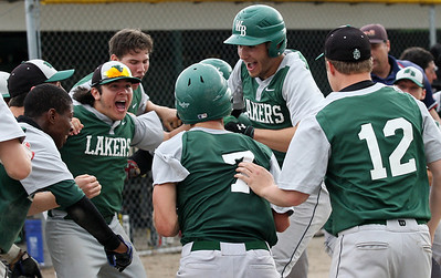 Chandler Sedat, West Bloomfield, celebrates with teammates after hitting a grand slam home run during district baseball action at Birmingham Groves High School Tuesday, May 27, 2014. (Special to The Oakland Press / LARRY McKEE)