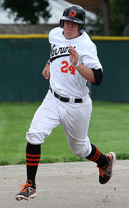 Jeff Timko, Birmingham Brother Rice, picks up some steam on his say to third base during district baseball action against West Bloomfield at Birmingham Groves High School Tuesday, May 27, 2014. (Special to The Oakland Press / LARRY McKEE)