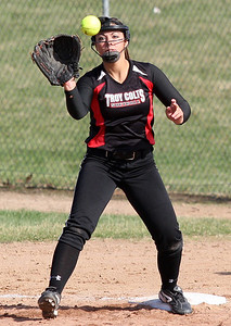 Cori Mittelbrun, Troy, makes a play at first base during varsity softball action at Clarkston Wednesday, April 23, 2014. (Special to The Oakland Press / LARRY McKEE)