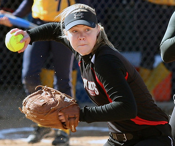 Sally Muller, Troy, attempts to throw out a base runner during varsity softball action at Clarkston Wednesday, April 23, 2014. (Special to The Oakland Press / LARRY McKEE)