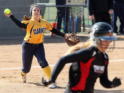 Mackenzie King, Clarkston, makes a play from her third base position during varsity softball action against Troy at Clarkston Wednesday, April 23, 2014. (Special to The Oakland Press / LARRY McKEE)