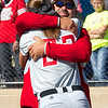 Special photo by Von Castor<br /> Hilldale assistant coach Mike Mills hugs his daughter Casady moments after the Lady Hornets captured the Class 4A fastpitch state title.