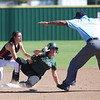 Special photo by Von Castor<br /> Muskogee's Shaylee Rowland slides safely into second base after a one-out double in the fourth inning of the Lady Roughers' Class 6A quarterfinal game against Mustang.