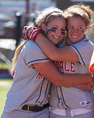 Special photo by Von Castor<br /> Hilldale's Destiny Riddle, left, and Jessie Casey embrace moments after the Lady Hornets captured the 4A state championship against Bethel
