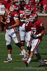 The offense celebrates OU's second touchdown as it comes off the field.