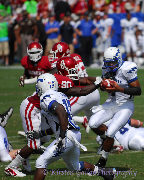 OU defensive end #90 David King gets the first grab on Jefferson.