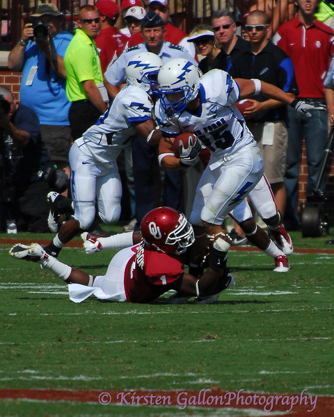#1 Tony Jefferson gets a hold of #15 Warzeka's leg and makes an open field tackle.