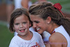 A young OU fan gets a photo with one of the cheerleaders.