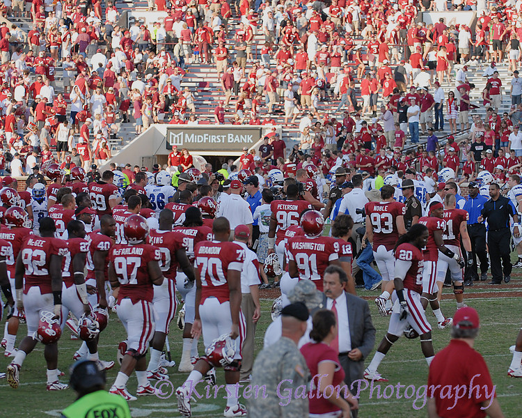 Everyones hits the field as teams congratulate each other at the end of the game.  OU barely pulls off the win over the Falcons, 27-24.
