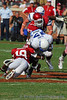 #19 Hurst  gets a leg hold on #17 running back Asher Clark.