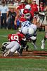 #19 Hurst  gets a leg hold on #17 running back Asher Clark.
