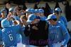 The Toreros gathers to congratulate #6 Lugo on a solo homerun.
