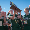 Senior Taylor Ladue hoists the hardware towards Oakmont fans along wth teammates Katherine Arsenault and Maddie Moran after defeating Quabog 5-1 in the Div II Field Hockey Championship. SENTINEL & ENTERPRISE / Jim Marabello