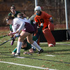 Cassidy Driscoll of Oakmont gets upended against Quabog in the Div II field hockey Championship game. SENTINEL & ENTERPRISE / Jim Marabello