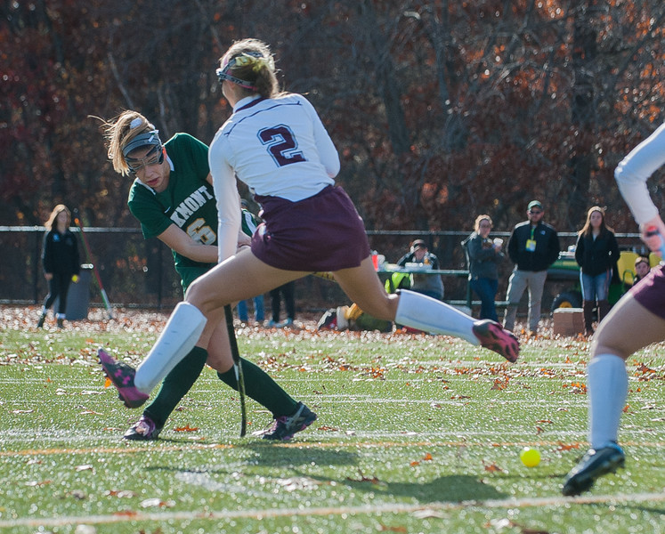 Maddie Moran of Oakmont fires a shot through the legs of Quabog's Emily Floury in the Div II field hockey Championship game.  SENTINEL & ENTERPRISE / Jim Marabello