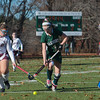Taylor Ladue of Oakmont runs by 2 Quabog defenders in the Div II field hockey Championship game.  SENTINEL & ENTERPRISE / Jim Marabello