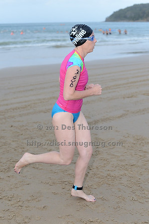 Mid Race / Half Way on Noosa Beach with a Laguna Bay backdrop - 2012 Eyeline 1000 Noosa Ocean Swim, Noosa Heads, Sunshine Coast, Queensland, Australia. Camera 1. Photos by Des Thureson. - The images in this gallery have not been edited / cropped. If you purchase* a print or download, these images will be edited / corrected / cropped before being sent out. *Ordering will be via disci.photoshelter.com or via email. Thanks, Des.
