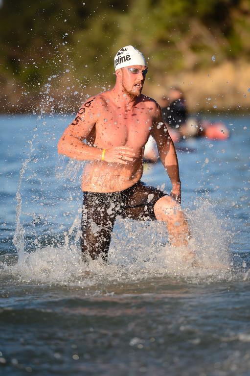 Michael Sheil - Men's Elite Division - Finish -  2013 Eyeline 1000 Noosa Ocean Swim, Noosa Heads, Sunshine Coast, Queensland, Australia, 1 November. Photos by Des Thureson disci.smugmug.com