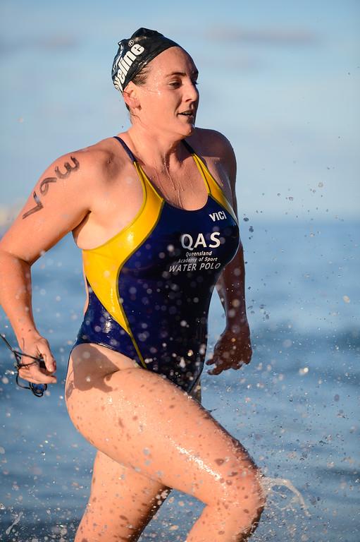 Women's Elite Division - Queensland Academy of Sport Water Polo Player - Finish -  2013 Eyeline 1000 Noosa Ocean Swim, Noosa Heads, Sunshine Coast, Queensland, Australia, 1 November. Photos by Des Thureson disci.smugmug.com