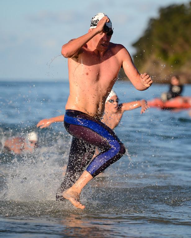 Trent Grimsey - Men's Elite Division - Finish -  2013 Eyeline 1000 Noosa Ocean Swim, Noosa Heads, Sunshine Coast, Queensland, Australia, 1 November. Photos by Des Thureson disci.smugmug.com