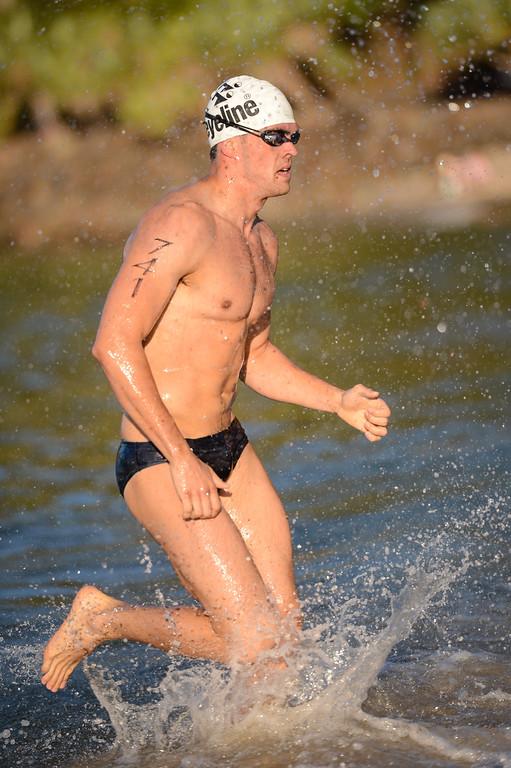 Dan Young - Men's Elite Division - Finish -  2013 Eyeline 1000 Noosa Ocean Swim, Noosa Heads, Sunshine Coast, Queensland, Australia, 1 November. Photos by Des Thureson disci.smugmug.com