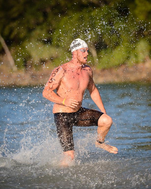 Michael Sheil - Men's Elite Division - Nice athletic stride - Finish -  2013 Eyeline 1000 Noosa Ocean Swim, Noosa Heads, Sunshine Coast, Queensland, Australia, 1 November. Photos by Des Thureson disci.smugmug.com