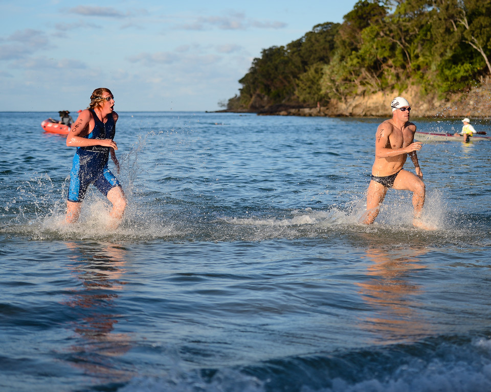 Codie Grimsey, Dan Young - Idyllic afternoon scene on Laguna Bay - Finish -  2013 Eyeline 1000 Noosa Ocean Swim, Noosa Heads, Sunshine Coast, Queensland, Australia, 1 November. Photos by Des Thureson disci.smugmug.com