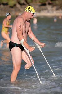 Brave Ocean Swimmer with a Disability - Finish -  2013 Eyeline 1000 Noosa Ocean Swim, Noosa Heads, Sunshine Coast, Queensland, Australia, 1 November. Photos by Des Thureson disci.smugmug.com