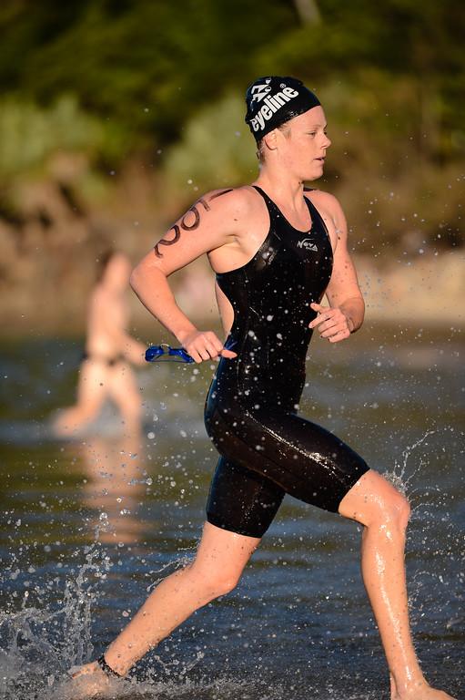 Danielle DeFrancesco - Women's Elite Division - Finish -  2013 Eyeline 1000 Noosa Ocean Swim, Noosa Heads, Sunshine Coast, Queensland, Australia, 1 November. Photos by Des Thureson disci.smugmug.com