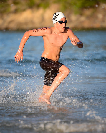Max Osborn - Men's Elite Division - Nice athletic stride - Finish -  2013 Eyeline 1000 Noosa Ocean Swim, Noosa Heads, Sunshine Coast, Queensland, Australia, 1 November. Photos by Des Thureson disci.smugmug.com