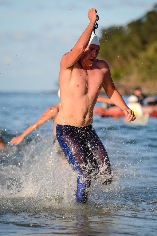 Trent Grimsey - Men's Elite Division - Finish -  2013 Eyeline 1000 Noosa Ocean Swim, Noosa Heads, Sunshine Coast, Queensland, Australia, 1 November. Photos by Des Thureson disci.smugmug.com