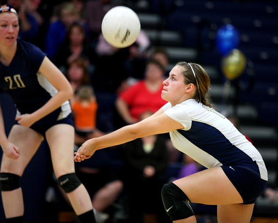 Morgan Breer of Teutopolis passes the ball to a teammate during a match against Mt. Zion. The Wooden Shoes were defeated on Senior Night 25-12, 25-21.