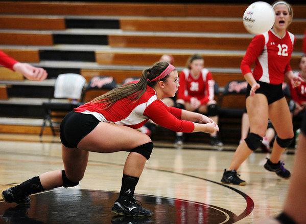Deedra Myers (left) of Effingham passes the ball to a teammate during the championship match of the IHSA Class 3A Olney Regional against Mattoon. The Hearts' season ended with a 25-16, 25-16 loss.