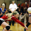 Megan Nuxoll of St. Anthony passes the ball to a teammate as Kassy Dammerman (left) watches the play during semifinals of the Class 2A Shelbyville Regional. The second-seeded Bulldogs won 25-12, 25-23 to advance to championship, where they will face top-seeded Pana.