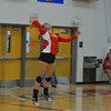 Effingham's Jennifer Fred jumps into the air and prepares to serve the ball during the Flaming Hearts' loss to Mattoon.