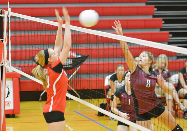 Dieterich's Mikayla Winters (8, right) tips the ball past Neoga's Jillian Deters during the Movin' Maroons loss to the Indians.