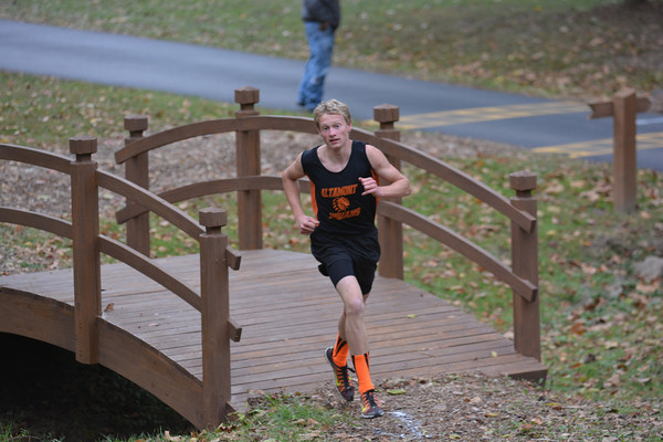 Altamont's Andrew Sharp crosses a bridge at Ballard Nature Center on his way to a first-place finish in a duel race against Dieterich.