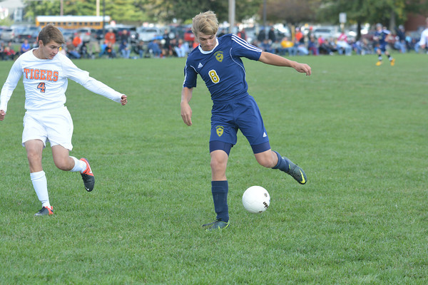 Teutopolis' Andrew Kowalski corrals the ball through his feet while Olney's Andrew Garrett pursues him defensively at the Olney Regional final.