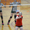 Neoga's Demmie Long hits a ball over her head and back toward the Stew-Stras defense during the NTC tournament.