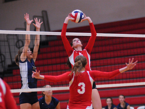 St. Anthony's Haylee Mathis sets for teammate Maggie Mumm (3). The Bulldogs rolled to a 25-17, 25-17 win over Teutopolis