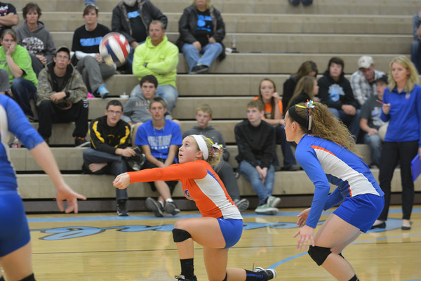 Newton's Emilee Johnson drops down to a knee and digs a ball out against the Cumberland Pirates.