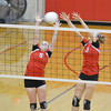 Neoga's Demmie Long (5) and Courtney Croy (3) go up for a block during the Indians' victory over Dieterich at the NTC tournament.
