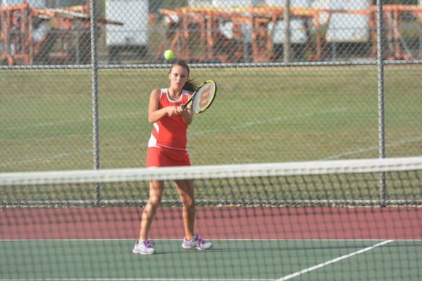 Effingham's Megan Allen returns a backhand during the first day of the Apollo Conference tennis tournament.