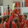 Anthony's Lauren Wendt (2, right) screams in celebration as the Bulldogs hold up their championship trophy plaque at the National Trail Conference tournament.