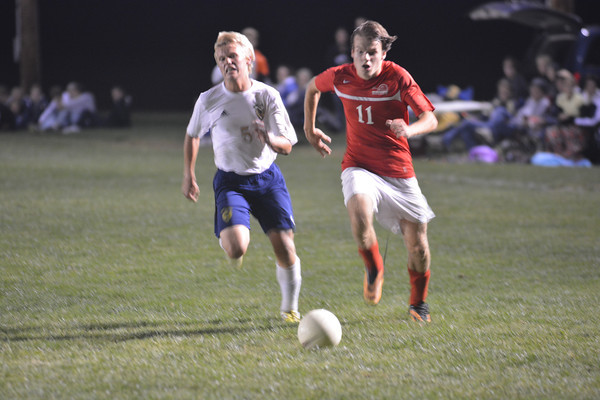 Teutopolis' Kyle Deters (left) and St. Anthony's Jonas Amberg (right) race for a ball during the Class 1A Olney Regional.