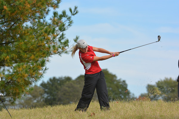 St. Anthony's Kelsea Dust hits her ball out of the tall grass at Effingham Country Club during the Effingham Sectional.