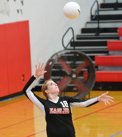 Beecher City's Caitlin Sloan serves the ball during the Eagles' match with Altamont.